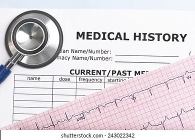 Patient medical history with electrocardiograph and stethoscope.