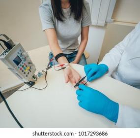 Patient nerves testing using electromyography. Medical examination. EMG
