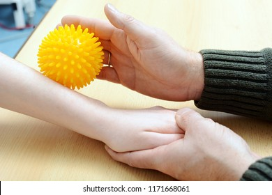 Patient at occupational therapy works with hedgehog ball to stimulate motor skills