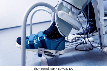 Patient on CPM (continuous passive range of motion) machines. Device to provide anatomically correct motion to both the ankle and subtalar joints. Foot's rehabilitation after injured
