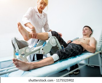 Patient on CPM (continuous passive range of motion) machines. Leg's rehabilitation after injured