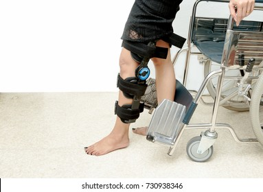 Patient on knee brace support try to walk training,Rehabilitation treatment