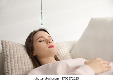 Patient on sofa during hypnotherapy session in office