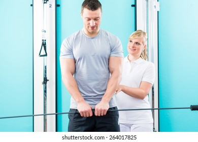 Patient at the physiotherapy doing physical exercises using flexi bar