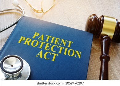 Patient protection act and gavel on a table.