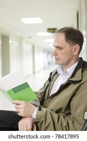 Patient reading the brochure in the clinic