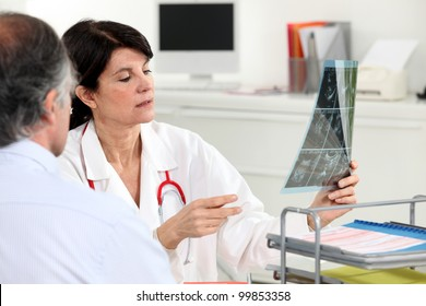 Patient receiving x-ray results