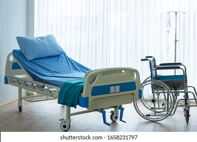 Patient room in hospital.  Bed and medical equipped with wheelchair for comfortable patient.  Healthy Concept