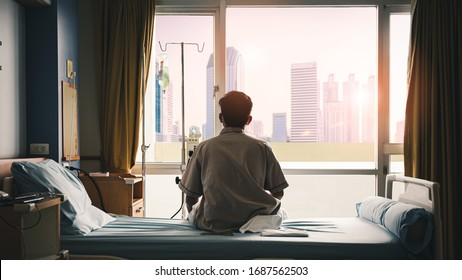 patient sat on the bed and looked out the window in the hospital alone and had stress, boredom, loneliness, anxiety. / Health care and medical