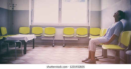 Patient sitting in a waiting room of a hospital