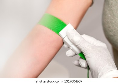 Patient with a tourniquet band on the arm, preparation for blood drawing, closeup
