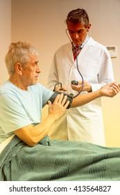 Patient undergoing scan test in hospital room.