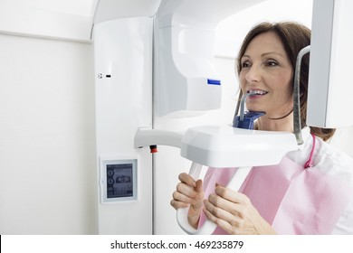 Patient Using Digital Panoramic Xray Machine While Looking Away
