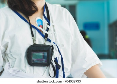 patient wearing holter monitor device for monitoring of an electrocardiogram 24 hour Heart investigation activity. woman in the hospital. Health care concept