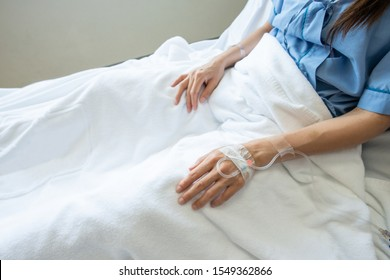 Patient woman sleeping with receiving intravenous fluid directly into a vein. Conceptual of Intravenous therapy, the fastest way to deliver medications and fluid replacement throughout the body.