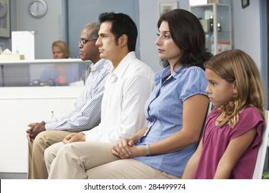 Patients In Doctors Waiting Room