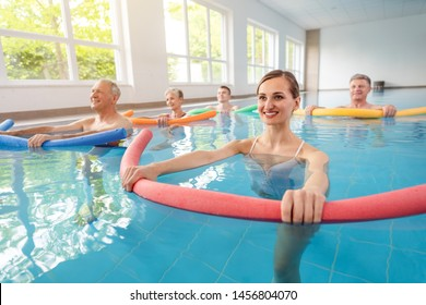 Patients during remobilization in a health center doing aquarobics in the water of a pool
