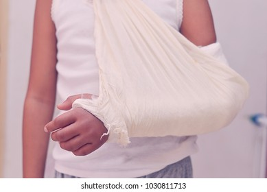 Patients forearm fracture.Paramedical using arm sling to stabilize.