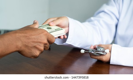 The patient's hand is sending money to the doctor for bribery in medical treatment.