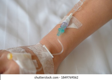 Patient's hand with Total Parenteral Nutrition (TPN) being administered into vein
