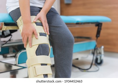 patient's leg is injured and the should not be bent.Knee brace supplies will help support your leg straight and aid in healing, Medical and healthcare concept