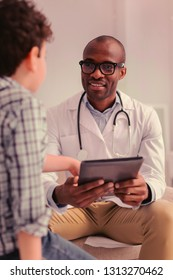 Patients needs. Doctor attentively listening to his young patient