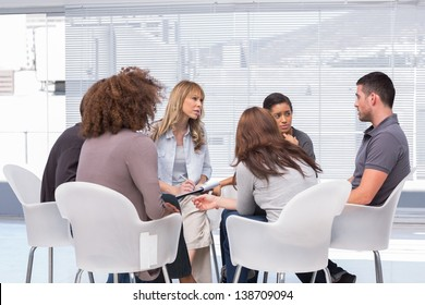 Patients telling their problems to therapist during session