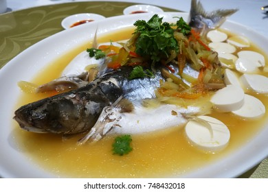 Patin silver catfish steamed with chinese style soya sauce and ginger. Famous food in south east asian countries