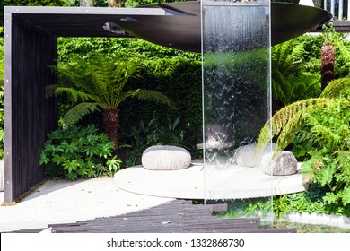 Patio area with a waterfall in a beautiful garden