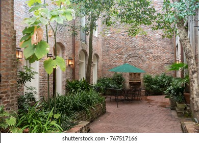 Patio with brick walls and greenery