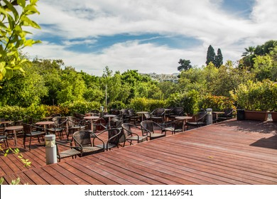 patio cafe restaurant area place with wooden furniture tables and chair in garden outdoor park environment