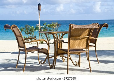 Patio Chairs and Table by a Caribbean Beach