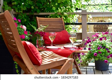 Patio deck and garden setting for secluded casual dining in home backyard for relaxing staycation evening on warm summer day