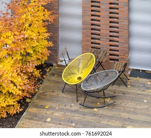 patio detail with garden furniture at autumn time