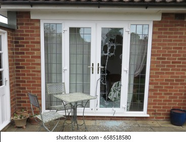 Patio doors smashed during a house robbery