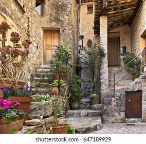 Patio with flowers in the old village Gourdon, France