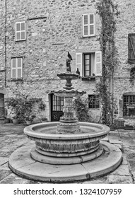 Patio with fountain in the old village Tourrettes-sur-Loup , France.