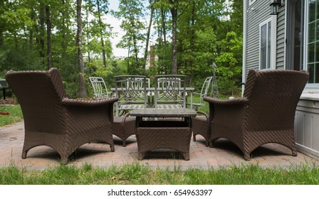 Patio furniture set up for lounging and relaxing in the summer. Back yard patio scene