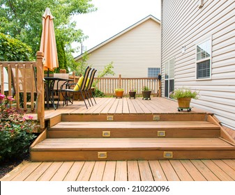 Patio and garden of family home at summer
