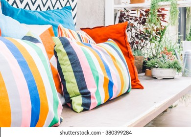 Patio outdoor deck with colorful pillow on chair decoration exterior of home - Vintage light filter