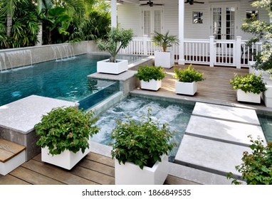 Patio with pool. A seating area in the backyard.