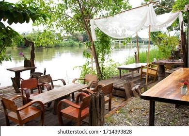 Patio terrace at riverside of Mae Khlong or Meklong river in retro vintage hotel resort for guest use service in evening time at Ratchaburi, Thailand