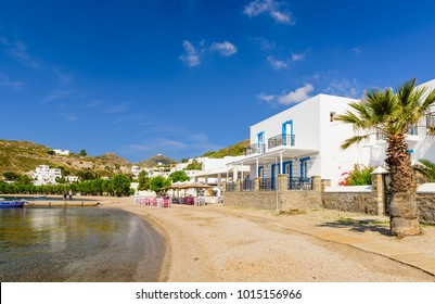 Patmos island, Dodecanese, Greece - May 28, 2017: the Bay of Grikos is a popular tourist place in the summer months, a traditional Greek village with colorful boats in the port