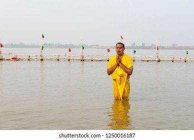 Patna / India 13 November 2018 A Hindu devotee man stands in the waters of River Ganga to offer prayers to the Sun god during Chhath Puja at Patna in Bihar northeast India