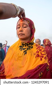 Patna / India 14 November 2018 A woman applies sindoor or vermillion on the forehead of another woman during Chhath Puja celebrations at Patna in Bihar northeast India