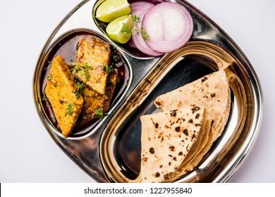 Patodi Rassa Bhaji or patwadi Sabji, a popular Maharashtrian spicy recipe served with Chapati and salad. Selective focus