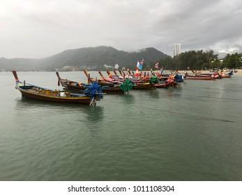 Patong beach, Phuket Thailand - 11 January 2018 : Fisherman boat was park at patong beach after sailing their boat