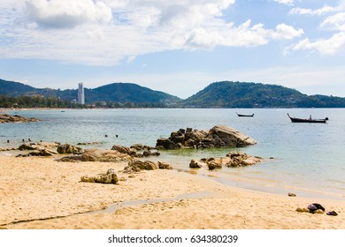 Patong, Thailand, February 4, 2017: View of the beach, high-rise building and boats at low tide.