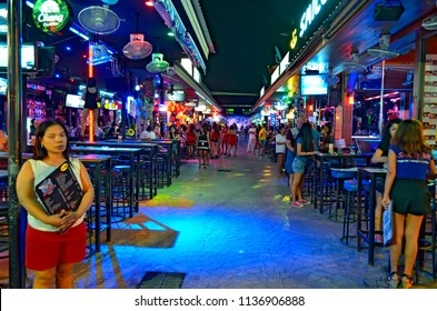 Patong, Thailand - October 13, 2014: A perpendicular soi in the famous red right district Bangla Road in Patong, a bustling street at night for adult entertainment,