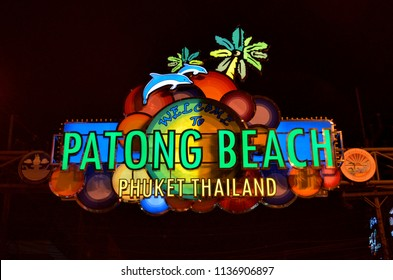 Patong, Thailand - October 13, 2014: Illuminated colorful sign welcoming visitors to the famous red right district Bangla Road in Patong, a bustling street at night for adult entertainment.
